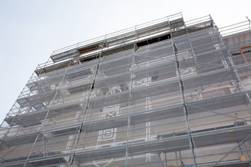 A urban apartments wall restoration works and scaffolding