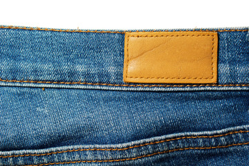 Blank leather label on blue jeans isolated on white