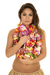 Hawaiian woman coconut bra close serious