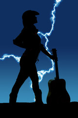 silhouette of a cowgirl with a guitar by her look to side