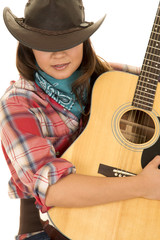 woman cowgirl with guitar eyes hidden