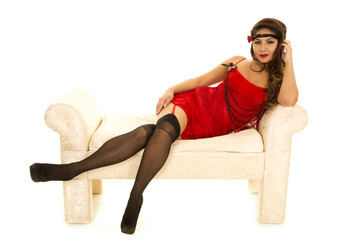 woman in red flapper outfit on couch
