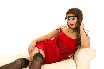 woman in red flapper outfit sit on side on couch