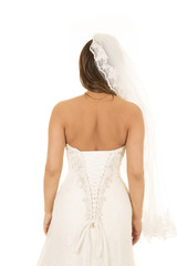 woman in wedding dress back look away