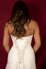 woman in wedding dress back on red