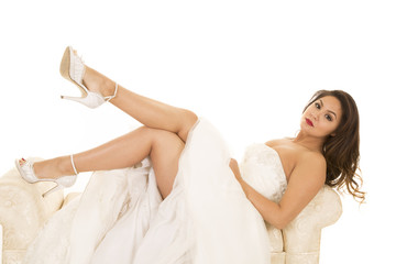 woman laying in wedding dress legs out look