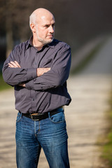 Confident attractive man standing waiting
