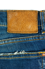 Blue jeans with leather label on white