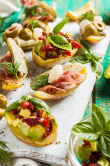 baked potato stuffed with avocado, bacon and vegetables