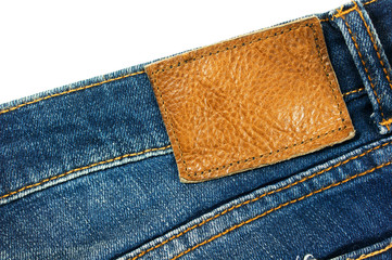 Jeans with brown leather label on white