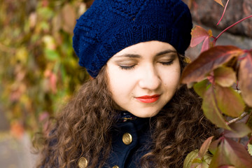 Portrait of young beautiful brunette in blue beret