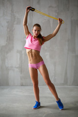 Athletic woman with resistance bands