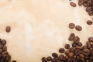 coffee beans are in a semicircle on the old paper