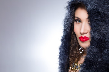 Girl with red lipstick and black fur