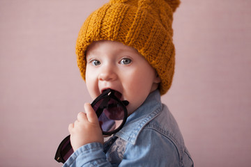 cute kid in knitted mustard color hat