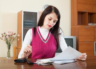 serious brunette girl reading documents