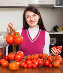 Happy housewife  with fresh tomatoes