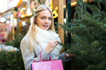 Blond woman at a holiday fair