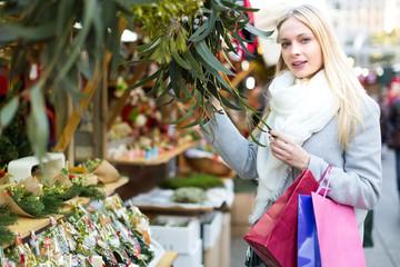 Woman buying eucalyptus at market