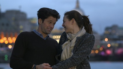 Attractive couple spending time together in London at night