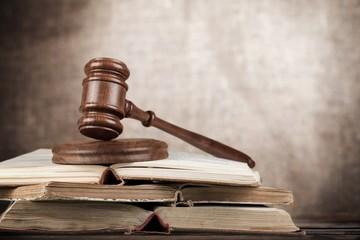 Law. Gavel on open books