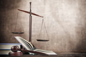 Legal. Golden scales of justice, gavel and books isolated on