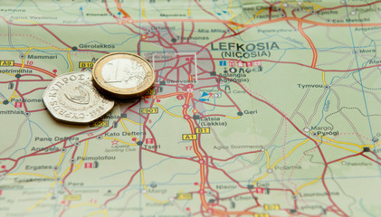 Euro coin and Cyprus cents on a map