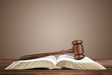 Legal System. Gavel over the opened law book