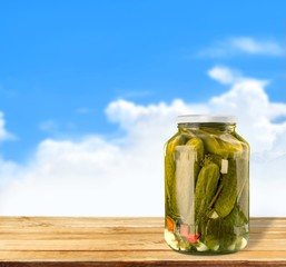 Canning. Fresh and pickled cucumbers, homemade preserved