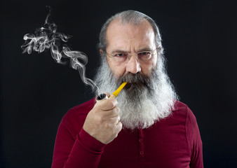 Senior portrait with white beard and pipe
