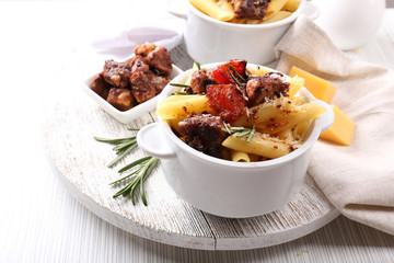 Tasty pasta with meat in ceramic pot