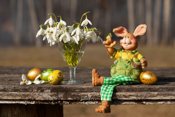 Easter, old table rabbit and snowdrops eggs