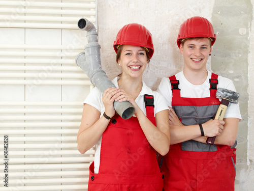 Two young worker having fun - 80482828