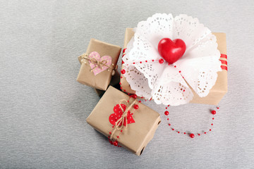 Beautiful gifts on grey background. Valentine Day concept