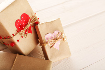 Beautiful gift boxes on wooden background. Valentine Day