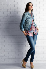 Pretty girl dressed in casual style posing
