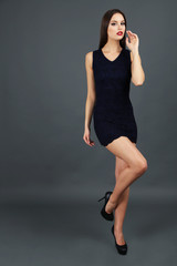 Beautiful young woman in short black dress