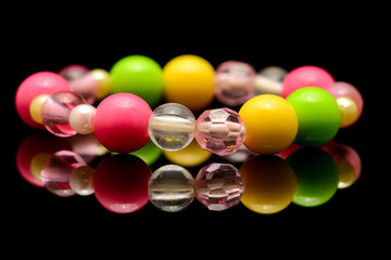 A colorful beaded bracelet isolated on black background