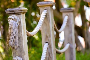 Wooden footbridge ropes in daylight