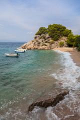 Coast of Croatia. Rocks, sea, boats and pine trees.