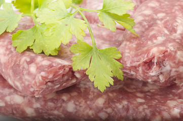 sausage with parsley leaves on the white