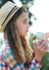 so cute girl with rabbit easter time