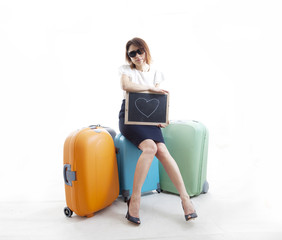 businesswoman with her suitcases waiting for love