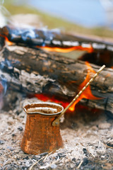 Making coffee in the fireplace  on camping or hiking in the natu