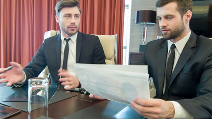 Handsome young businessmen at work