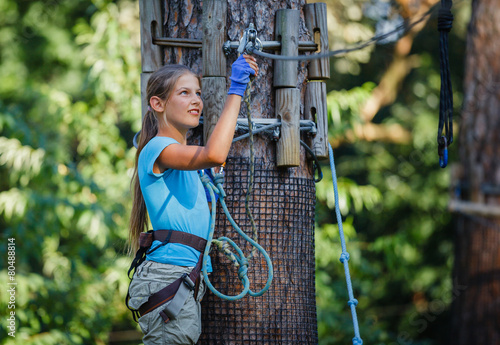 Girl in a climbing adventure park