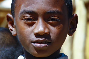 Very handsome african boy with shadow on his face, poverty in Ma
