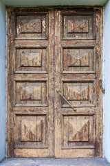 Old wooden door with cracked paints