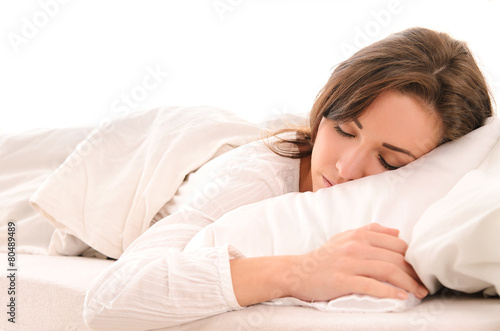 sleeping young woman in white - 80489489