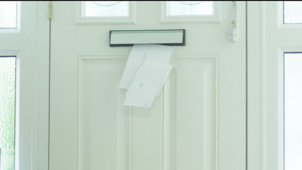 Letters and bills being delivered by the postal service